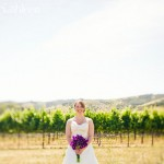 Bride with Purple Floral Arrangement